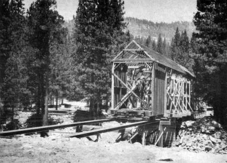 Covered bridge. Easing the Wawona covered bridge back into place.