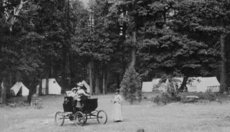 One of the first cars to reach Yosemite at Camp Curry