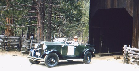 Ranger Norm Bishop drives acroos the Wawona Covered Bridge