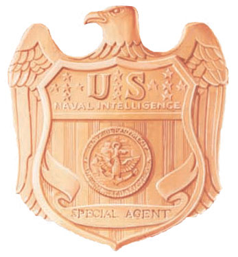 The seal of the Naval Investigative Service. Click Image To Go To Amazon