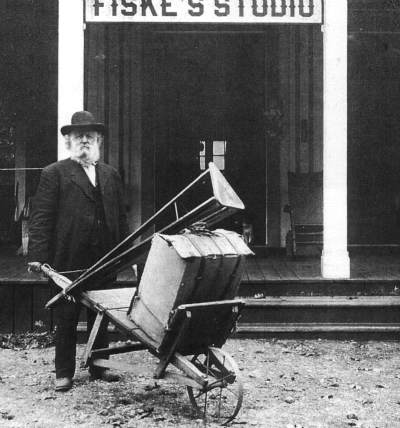 Early Yosemite photographer Fiske outside his studio